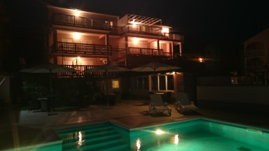 Apartments Dania - pool in the night